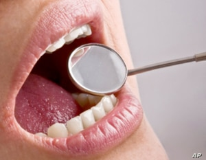 Fluoride disease is blamed for an outbreak in China that blackened teeth, caused very brittle bones and bone deformation.