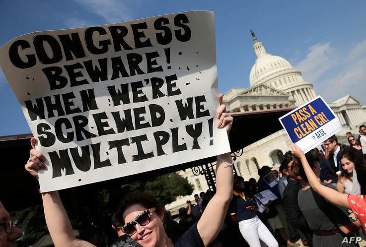 Furloughed federal workers protest outside the U.S. Capitol to demand an end to the lockout of federal workers caused by the government shutdown October 4, 2013 in Washington, DC.