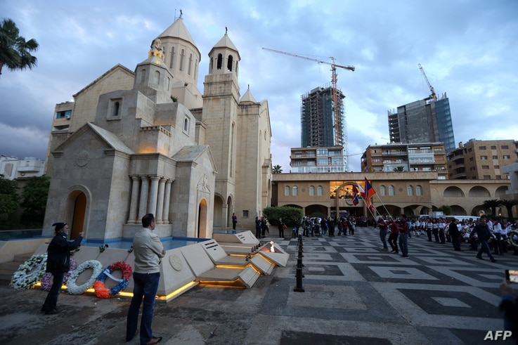 FILE - Lebanese-Armenians attend a ceremony at the Armenian Martyrs memorial at the Saint Stephano church on the eve of the 100 hundred year anniversary of the Armenians massacred by Ottoman forces a century ago, in the Armenian Orthodox Archdeocese ...