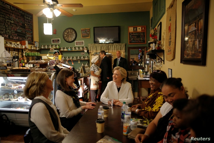 U.S. Democratic presidential nominee Hillary Clinton talks to supporters at Reed's Coffee and Tea House in Philadelphia, Pennsylvania, Nov. 5, 2016.