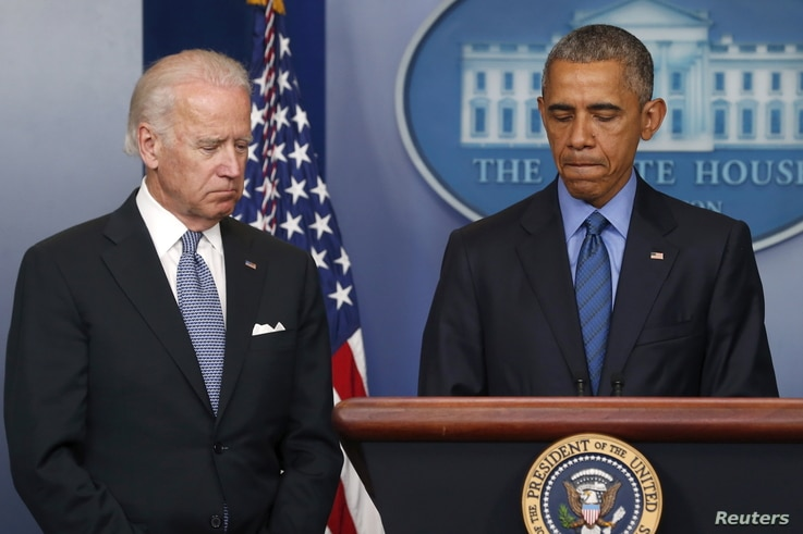 U.S. President Barack Obama (R) delivers remarks in reaction to the shooting deaths of nine people at an African-American church in Charleston, South Carolina, from the podium in the press briefing room of the White House in Washington, June 18, 2015...