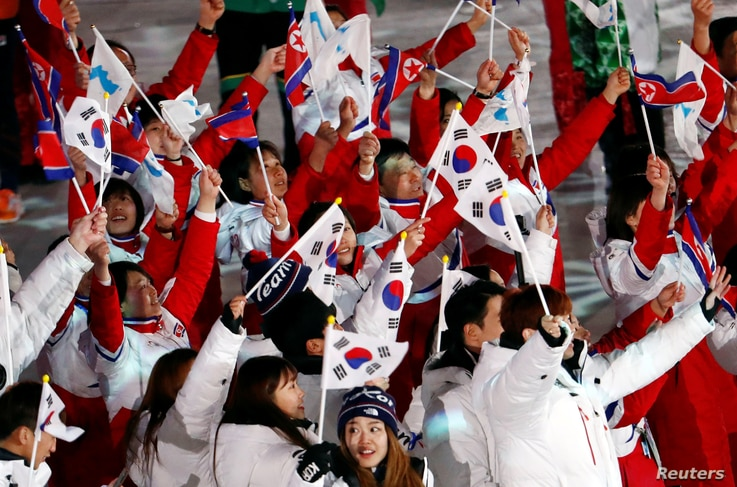 Athletes from North Korea and South Korea celebrate during the closing ceremony at the Pyeongchang 2018 Winter Olympics.