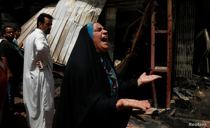 A woman reacts at the scene of a car bomb attack in Baghdad's mainly Shi'ite district of Sadr City, Iraq, May 11, 2016.