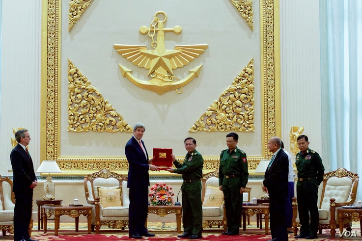 U.S. Secretary of State John Kerry receives a gift from Myanmar Commander-in-Chief Min Aung Hliang, following a bilateral meeting at the Commander-in-Chief's Compound in Naypyitaw, Myanmar, May 22, 2016.