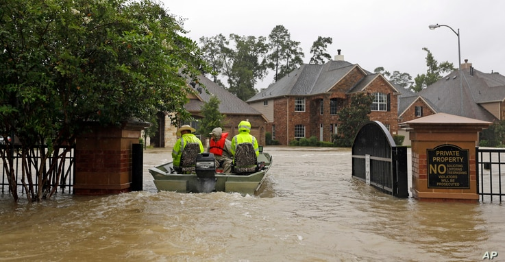 Volunteer rescue boats enter a flooded subdivision looking to evacuate residents as floodwaters from Tropical Storm Harvey rise in Spring, Texas, Aug. 28, 2017.