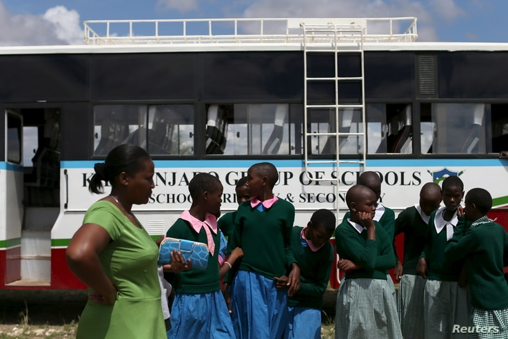 FILE - Students arrive at the start of a social event advocating against harmful practices such as female genital mutilation at the Imbirikani Girls High School in Imbirikani, Kenya, April 21, 2016.