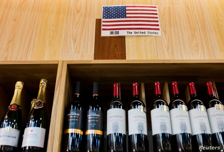 FILE - The U.S. flag is seen in the wine section of a supermarket in Beijing, China, April 5, 2018.