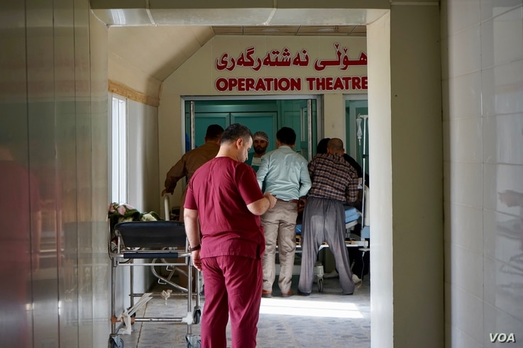 Medical staff prepared another patient for surgery — civilian casualties are rising, they say. (J. Dettmer/VOA)