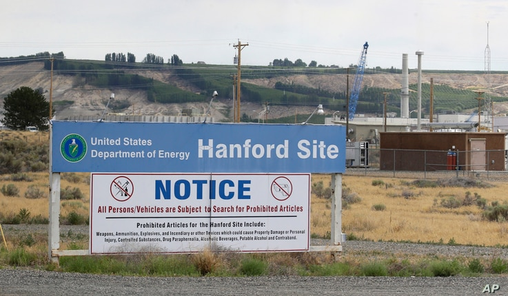 FILE - In this July 9, 2014, photo, a sign informs visitors of prohibited items on the Hanford Nuclear Reservation near Richland, Washington. An emergency has been declared  May 9, 2017, at the Hanford Nuclear Reservation.