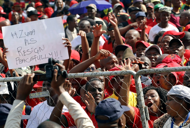 Workers hold placards during a May Day rally in Bloemfontein, South Africa,  May 1, 2017.