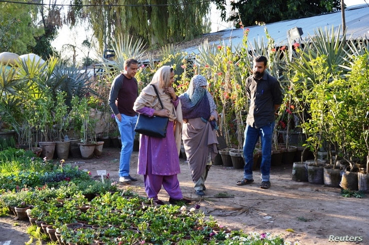 A family looks at plants at a nursery in H-9 neighborhood of Islamabad, Pakistan's capital, March 7, 2018.
