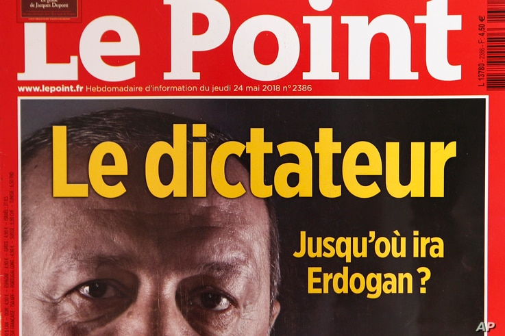 "A photo dated May 30, 2018, shows a part of the front cover of French weekly news magazine ""Le Point"" featuring Turkish President Recep Tayyip Erdogan and the headline ""dictateur"", in Paris, France."