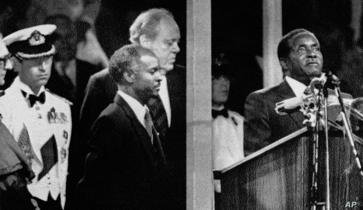 During the Independence celebrations, on April 18, 1980, Prime Minister Robert Mugabe takes the oath of allegiance to Zimbabwe in Highfields, Harare, Zimbabwe.