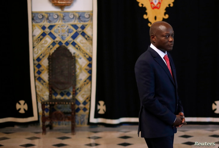 FILE - Guinea-Bissau President Jose Mario Vaz arrives to speak with journalists after a meeting with Portuguese officials at the presidential palace in Lisbon, June 19, 2014.