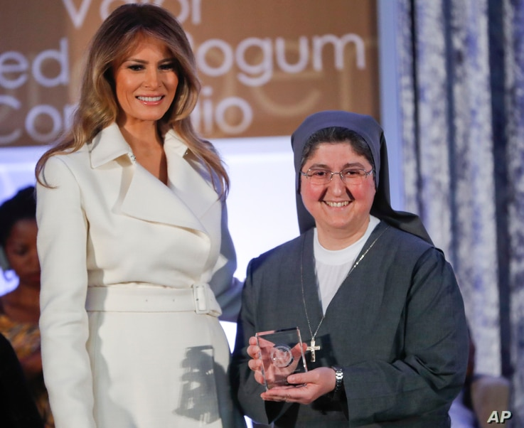 First lady Melania Trump presents the 2017 Secretary's of State's International Women of Courage (IWOC) Award to Sister Carolin Tahhan Fachakh from Syria, March 29, 2017, at the State Department in Washington.