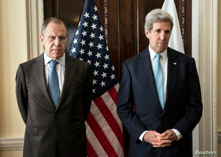 U.S. Secretary of State John Kerry (R) and Russia's Foreign Minister Sergei Lavrov pose for a photograph before their meeting at Winfield House, the home of the U.S. ambassador in London March 14, 2014.