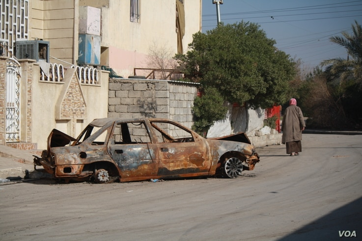 In  areas of Mosul controlled by  Iraqi forces, the remnants of car bombs remain strewn on the street, Jan. 11, 2017.