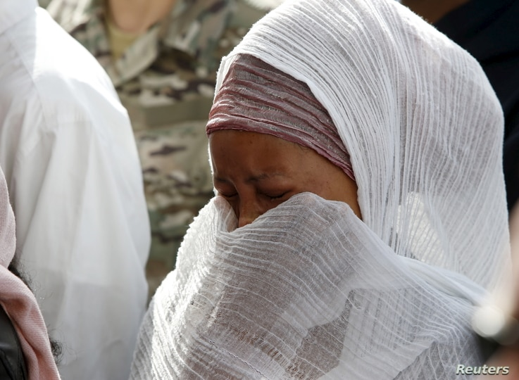 A migrant cries during an inter-faith burial service for 24 dead migrants at Mater Dei Hospital in Tal-Qroqq, outside Valletta, April 23, 2015. European Union leaders who decided last year to halt the rescue of migrants trying to cross the Mediterran...