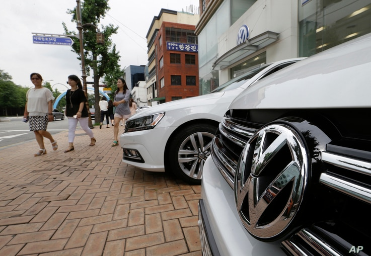 The Volkswagen emblem is seen on a vehicle in front of a dealership in Seoul, South Korea, Tuesday, Aug. 2, 2016.