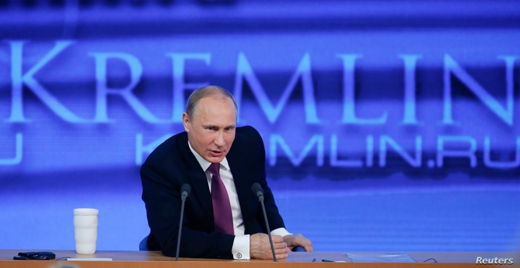 """FILE - Russian President Vladimir Putin speaks during his annual end-of-year news conference in Moscow, Dec. 18, 2014. Putin said on Thursday former oil tycoon Mikhail Khodorkovsky, one of his biggest critics, had the right to engage in politics """"as ..."""