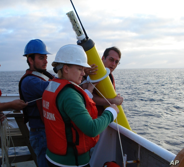 This photo provided by NOAA Corps shows the deployment of an Argo float to capture ocean temperature data.