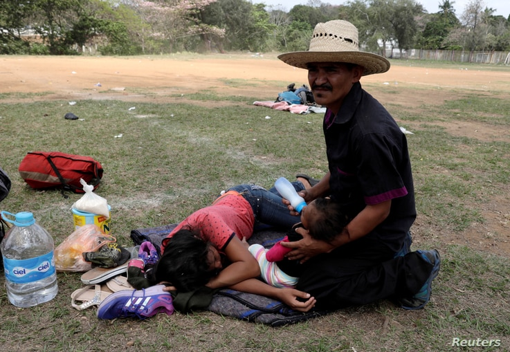 Central American migrants take a break from traveling in their caravan, as they journey to the U.S., in Matias Romero, Oaxaca, Mexico, April 3, 2018.