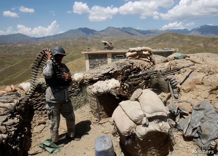 An Afghan border policeman prepares ammunition at a check post at the Goshta district of Nangarhar province, where Afghanistan shares borders with Pakistan, May 8, 2013.