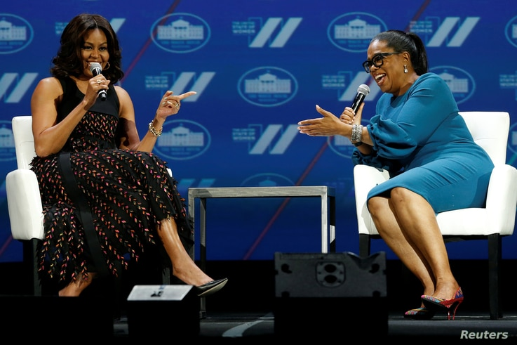 "FILE - First lady Michelle Obama and television presenter Oprah Winfrey participate in the White House's ""United State of Women"" summit in Washington, June 14, 2016."