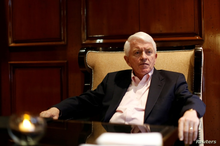 FILE - Tom Donohue, president of U.S. Chamber of Commerce, gestures during an interview with Reuters in Mexico City, Mexico, April 23, 2017.