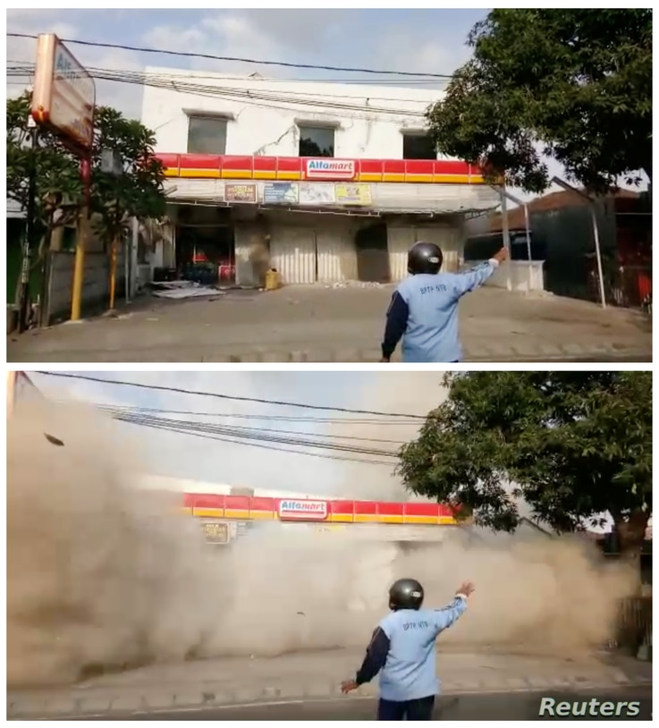 A combo picture shows a man directing people away from the building during the collapse due to an earthquake, Indonesia August 9, 2018 in these still images taken from a video obtained from social media.