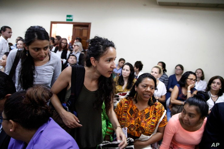 Bertha Zuniga Caceres, center, daughter of the murdered Honduran environmentalist Berta Caceres, arrives in court for the trail of her mother's muder, in Tegucigalpa, Honduras, Sept. 17, 2018.