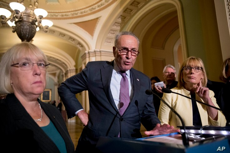 FILE - Senate Minority Leader Sen. Chuck Schumer of N.Y., accompanied by Sen. Patty Murray, D-Wash., left, and Sen. Maggie Hassan, D-N.H., right, speaks to reporters as Senate Republicans faced defeat on the Graham-Cassidy bill, the GOP's latest atte...
