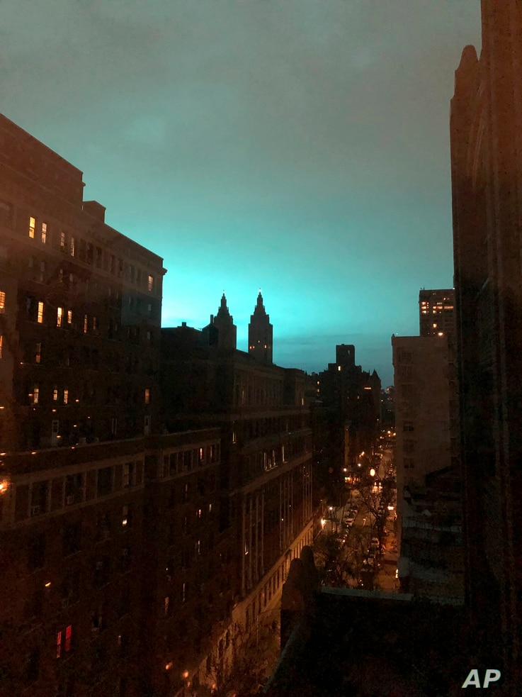 This photo shows blue light over New York, as seen from New York's Manhattan borough on Dec. 27, 2018.