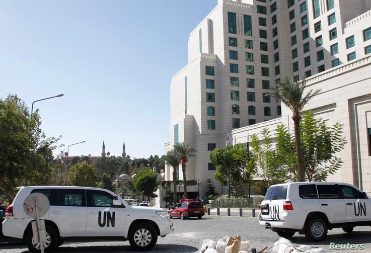 United Nations vehicles are parked in front of the Four Seasons hotel, where a team of experts from the Organisation for the Prohibition of Chemical Weapons (OPCW) are staying in Damascus, Oct. 22, 2013.