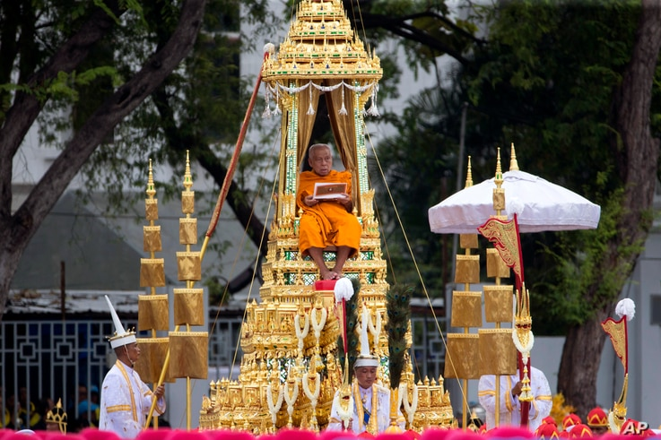Supreme Patriarch is transported in a royal chariot during the funeral procession of Thailand's late King Bhumibol Adulyadej in Bangkok, Thailand, Oct. 26, 2017.