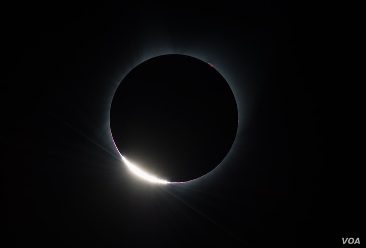 The Diamond Ring  effect is seen as the moon makes its final move over the sun during the total solar eclipse, August 21, 2017 above Madras, Oregon.