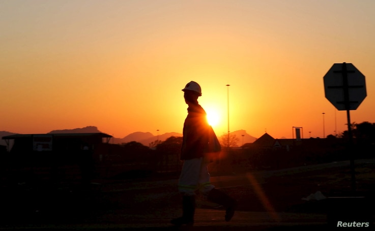 A miner returns from his shift in Nkaneng township outside the Lonmin mine in Rustenburg, northwest of Johannesburg, June 26, 2015.