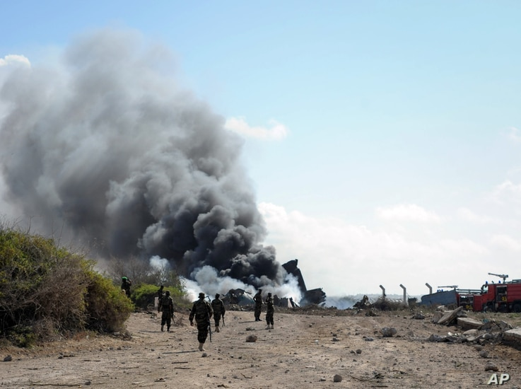 African Union Mission in Somalia firefighters attempt to extinguish the fire at the site of an airplane crash in Mogadishu, Somalia, August 9, 2013. (AMISOM)