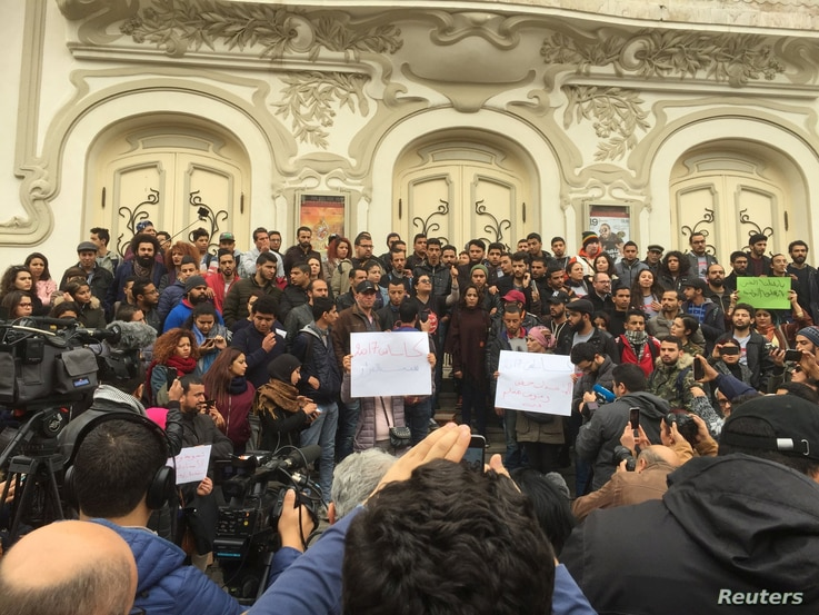Tunisian activist speaks in front of anti-government protestors in Tunis, Tunisia, Jan. 10, 2018 in this picture taken from social media.