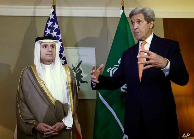 U.S. Secretary of State John Kerry, right, gestures next to Saudi Foreign Minister Adel al-Jubeir, left, during a meeting on Syria in Geneva, Switzerland, May 2, 2016.