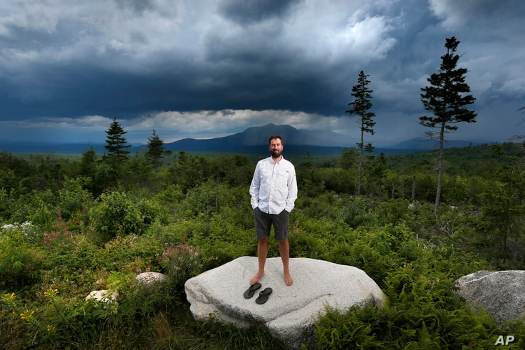FILE - Lucas St. Clair, the son of Burt's Bees founder Roxanne Quimby, poses on land proposed for a national park in Penobscot County, Maine, Aug. 4, 2015.