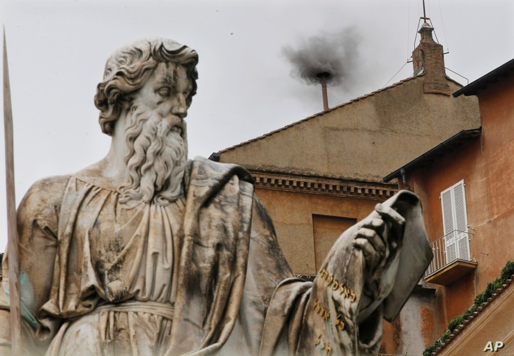 Black smoke emerges from the chimney on the Sistine Chapel as cardinals voted on the second day of the conclave to elect a pope in St. Peter's Square at the Vatican, March 13, 2013.