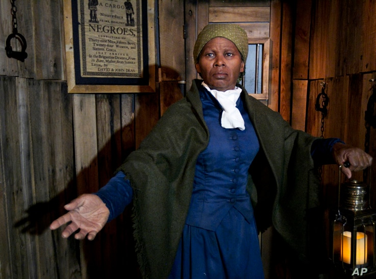 FILE - A wax likeness of Harriet Tubman, renowned abolitionist and conductor of the Underground Railroad, is unveiled at the Presidents Gallery by Madame Tussauds in Washington, Feb. 7, 2012.