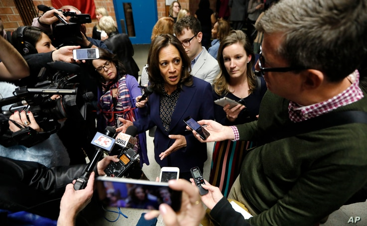 U.S. Sen. Kamala Harris, D-Calif., center, speaks to reporters following a get out the vote rally, Oct. 22, 2018, at Des Moines Area Community College in Ankeny, Iowa.