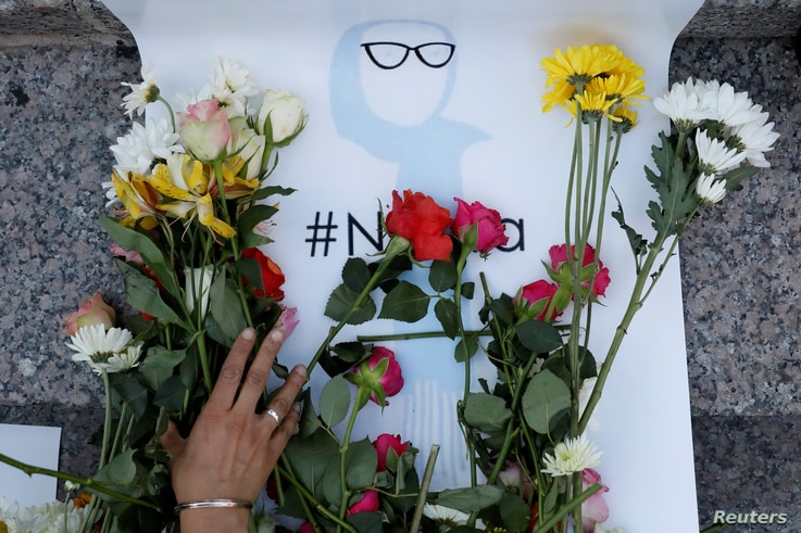 An attendee leaves flowers for Nabra Hassanen, a teenage Muslim girl killed by a bat-wielding motorist near a Virginia mosque, during a vigil in New York City, June 20, 2017.