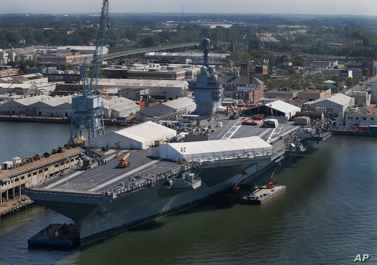 The USS Gerald R. Ford is seen at Newport News Shipbuilding in Newport News, Virginia, April 27, 2016. The $13 billion warship, the first of the Navy's next generation of aircraft carriers, is in the final stages of construction after delays and co...