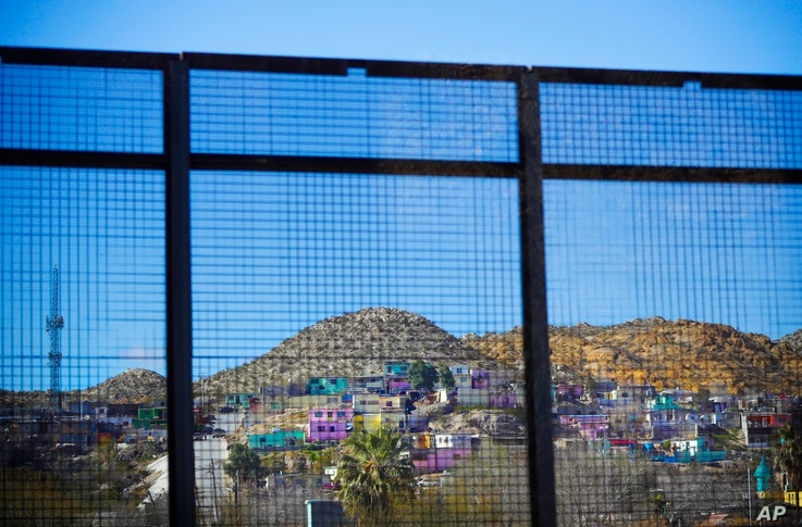 Residential homes in the Mexican city of Ciudad Juarez are seen through border fencing during Acting Secretary of Defense Patrick Shanahan's tour of the U.S.-Mexico border in El Paso, Texas, Feb. 23, 2019.
