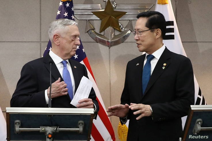 U.S. Secretary of Defense James Mattis, left, talks with South Korean Defense Minister Song Young-moo before their meeting, June 28, 2018 in Seoul, South Korea.