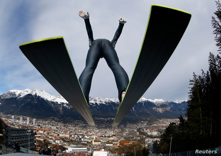Austria's Gregor Schlierenzauer takes off from the ski jump during the first practice session of the third jumping of the four-hills tournament in Innsbruck, Jan. 3, 2014.