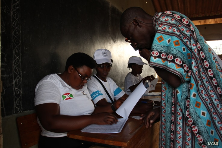 Burundi's National Election workers check the name of a voter in Cibitoke neighborhood, one of the areas worst hit by weeks of deadly protests in the capital, Bujumbura.